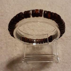 A brown wood braclet